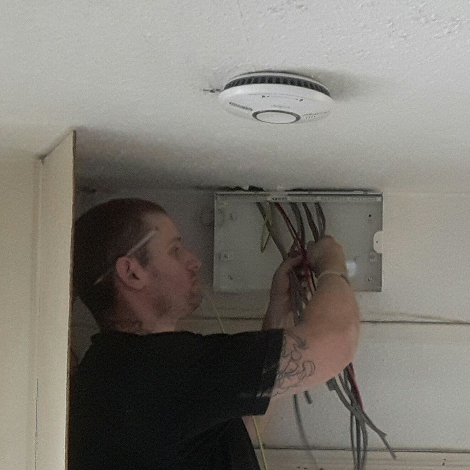 Electrician changing a fuse board in Bristol